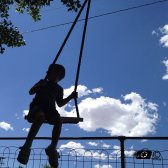 boy_on_a_tree_swing_by_fotomedic-d522qst